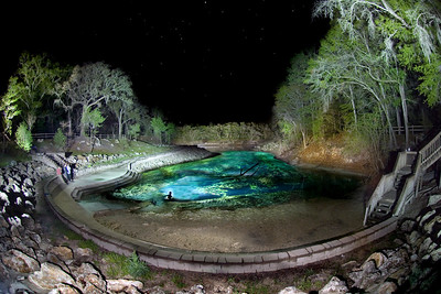 A lone cave diver prepares to enter the water filled passages of Little River Spring  on the Suwannee River near Branford, Florida.