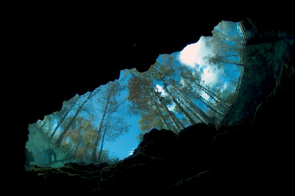 The view from inside the planet as a cave diver peers through the clear water at Little Devil Spring in Ginnie Springs, High Springs, Florida.